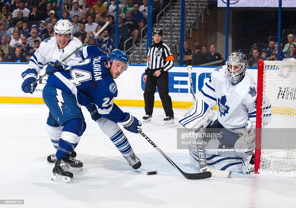 <a gi-track='captionPersonalityLinkClicked' href=/galleries/search?phrase=Ryan+Callahan&family=editorial&specificpeople=809690 ng-click='$event.stopPropagation()'>Ryan Callahan</a> #24 of the Tampa Bay Lightning tries to deflect a shot against goalie <a gi-track='captionPersonalityLinkClicked' href=/galleries/search?phrase=James+Reimer+-+Hockey&family=editorial&specificpeople=7543302 ng-click='$event.stopPropagation()'>James Reimer</a> #34 and <a gi-track='captionPersonalityLinkClicked' href=/galleries/search?phrase=Dion+Phaneuf&family=editorial&specificpeople=545455 ng-click='$event.stopPropagation()'>Dion Phaneuf</a> #3 of the Toronto Maple Leafs during the first period at the Amalie Arena on December 29, 2014 in Tampa, Florida.