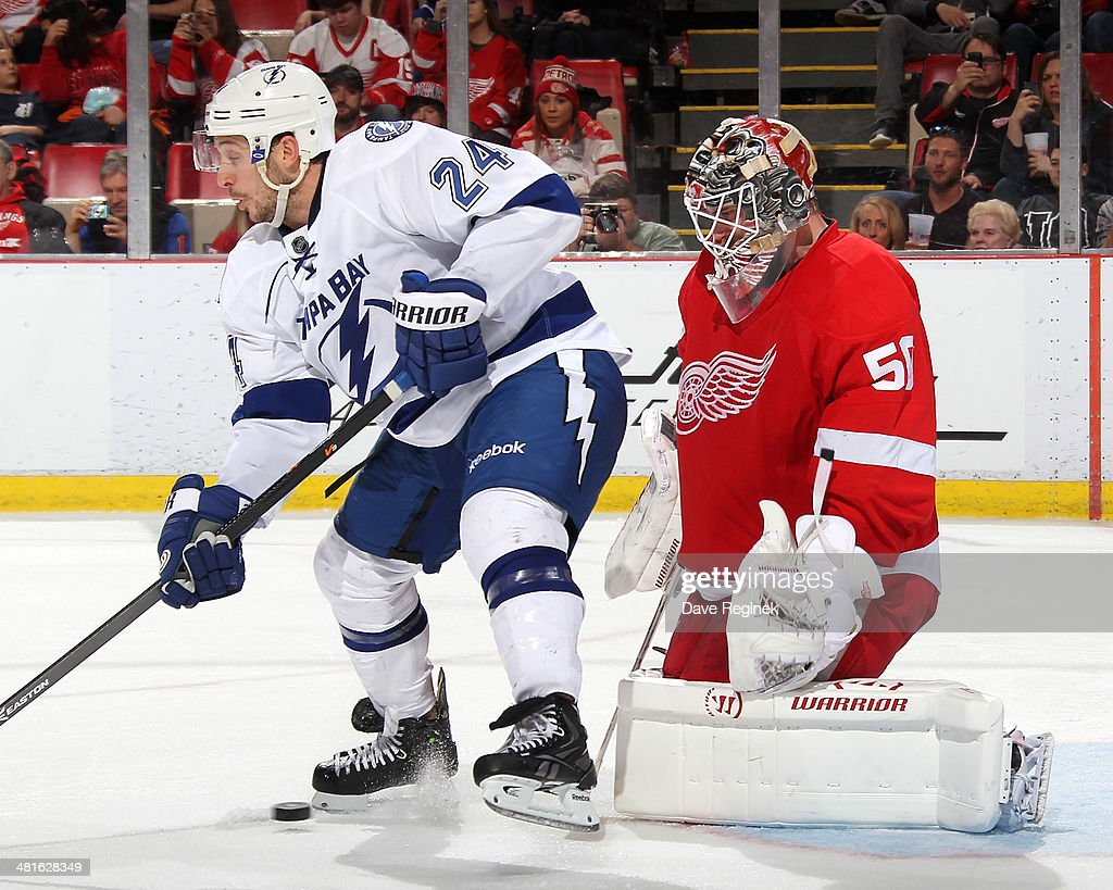 <a gi-track='captionPersonalityLinkClicked' href=/galleries/search?phrase=Ryan+Callahan&family=editorial&specificpeople=809690 ng-click='$event.stopPropagation()'>Ryan Callahan</a> #24 of the Tampa Bay Lightning tries to tip the puck past goalie <a gi-track='captionPersonalityLinkClicked' href=/galleries/search?phrase=Jonas+Gustavsson&family=editorial&specificpeople=886789 ng-click='$event.stopPropagation()'>Jonas Gustavsson</a> #50 of the Detroit Red Wings during an NHL game on March 30, 2014 at Joe Louis Arena in Detroit, Michigan. Detroit defeated Tampa Bay 3-2