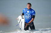 Ryan Callinan of Australia exits the water after winning his Round 4 Heat at the Vans US Open of Surfing on August 1 2015 in Huntington Beach...