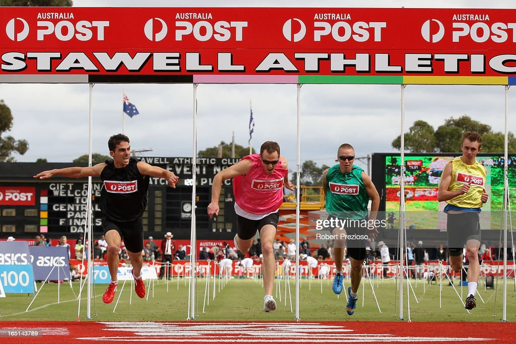 Ryan Camille (L) crosses the line to win in the Australia Post Stawell Gift 120m Semi Final 1 during the 2013 Stawell Gift carnival at Central Park on April 1, 2013 in Stawell, Australia.