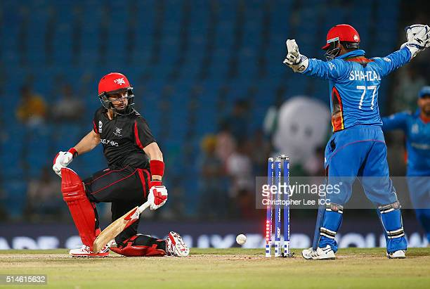 Ryan Campbell of Hong Kong hits the ball onto his wicket and is out off the bowling of Mohammad Nabi of Afghanistan during the ICC Twenty20 World Cup...
