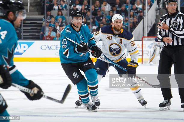 Ryan Carpenter of the San Jose Sharks skates against Ryan O'Reilly of the Buffalo Sabres at SAP Center on October 12 2017 in San Jose California