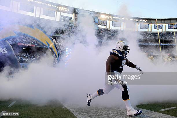 Ryan Carrethers of San Diego Chargers enters the field against the Dallas Cowboys during their NFL Preseason game at Qualcomm Stadium on August 13...
