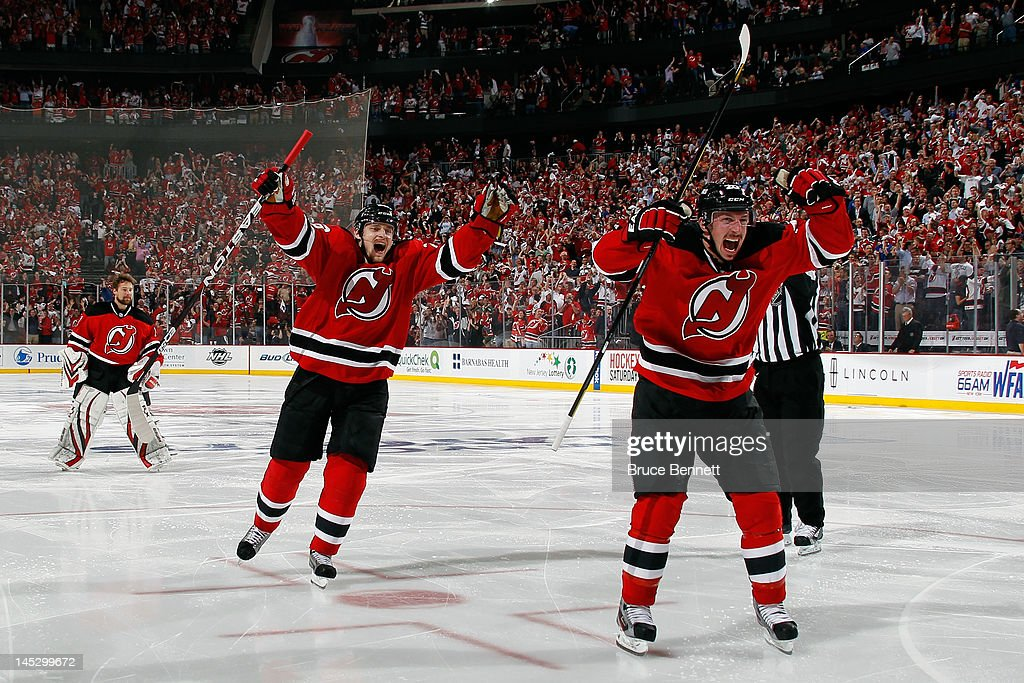 Ryan Carter and Anton Volchenkov of the New Jersey Devils celebrate after the game winning goal by Adam Henrique in overtime against the New York...