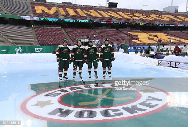 Ryan Carter Mike Reilly Matt Dumba and Nate Prosser of the Minnesota Wild stand in position at an auxiliary rink during practice for the 2016 Coors...