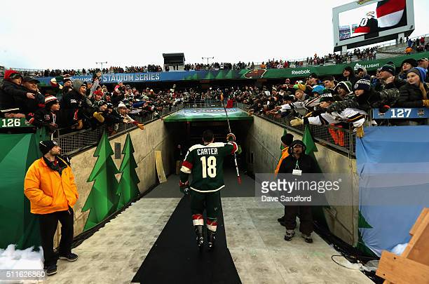 Ryan Carter of the Minnesota Wild acknowledges the fans on his way back to the locker room after the 2016 Coors Light Stadium Series game against the...