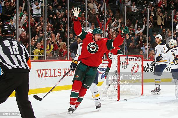 Ryan Carter of the Minnesota Wild celebrates after scoring a goal against the Buffalo Sabres during the game on November 13 2014 at the Xcel Energy...