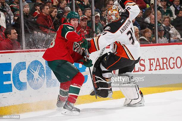 Ryan Carter of the Minnesota Wild makes contact with goalie Frederik Andersen of the Anaheim Ducks during the game on December 5 2014 at the Xcel...