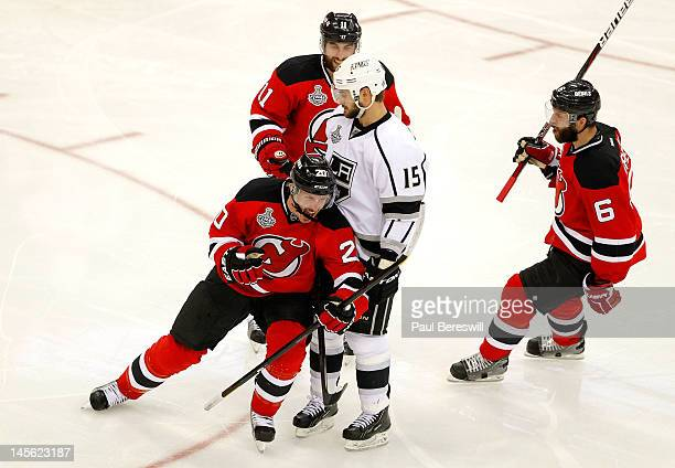 Ryan Carter of the New Jersey Devils celebrates after scoring a goal in the third period as Stephen Gionta and Andy Greene look on with Brad...