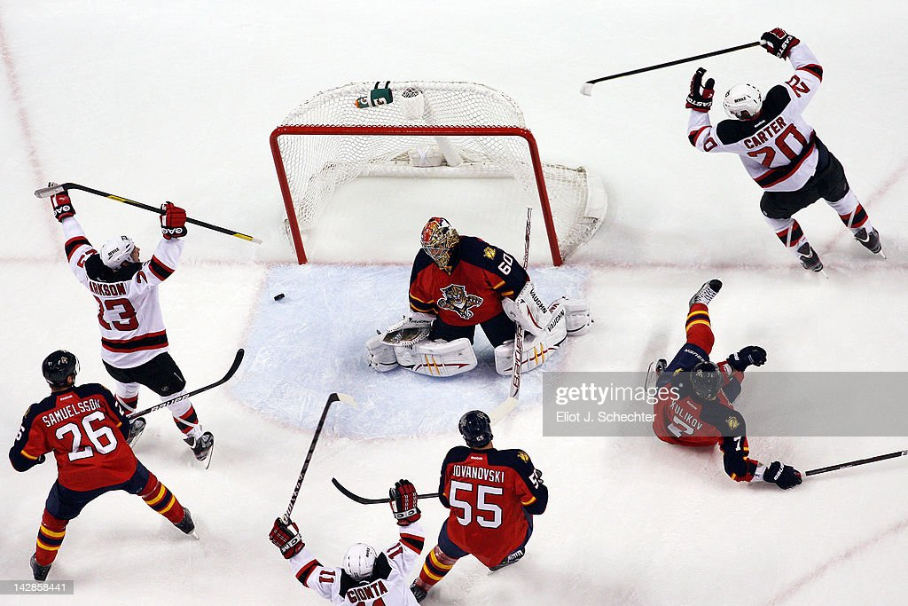 Ryan Carter of the New Jersey Devils celebrates his goal with teammate David Clarkson against Goaltender Jose Theodore of the Florida Panthers in...
