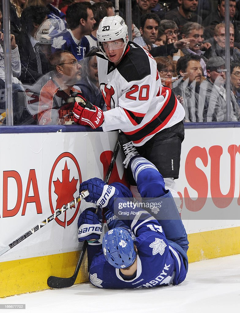 Ryan Carter #20 of the New Jersey Devils checks James van Riemsdyk #21 of the Toronto Maple Leafs during NHL game action April 15, 2013 at the Air Canada Centre in Toronto, Ontario, Canada.