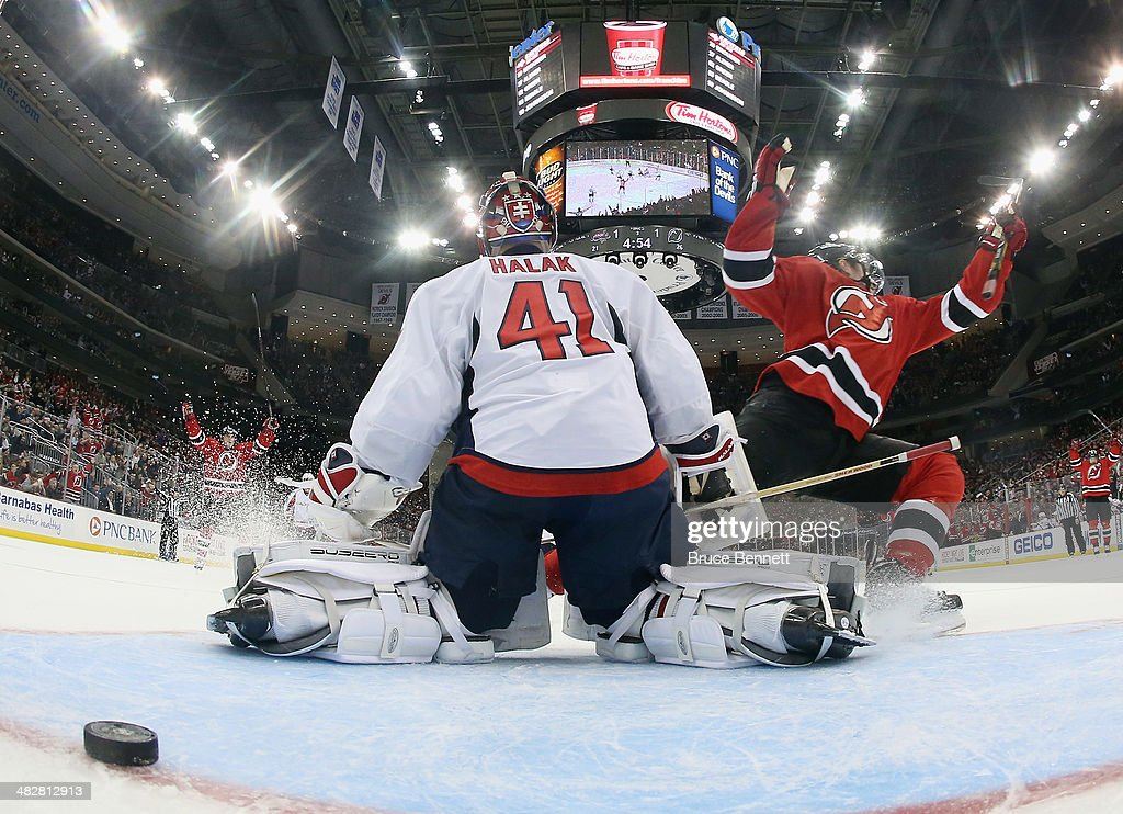Ryan Carter of the New Jersey Devils scores the game winning goal at 1506 of the third period against Jaroslav Halak of the Washington Capitals at...