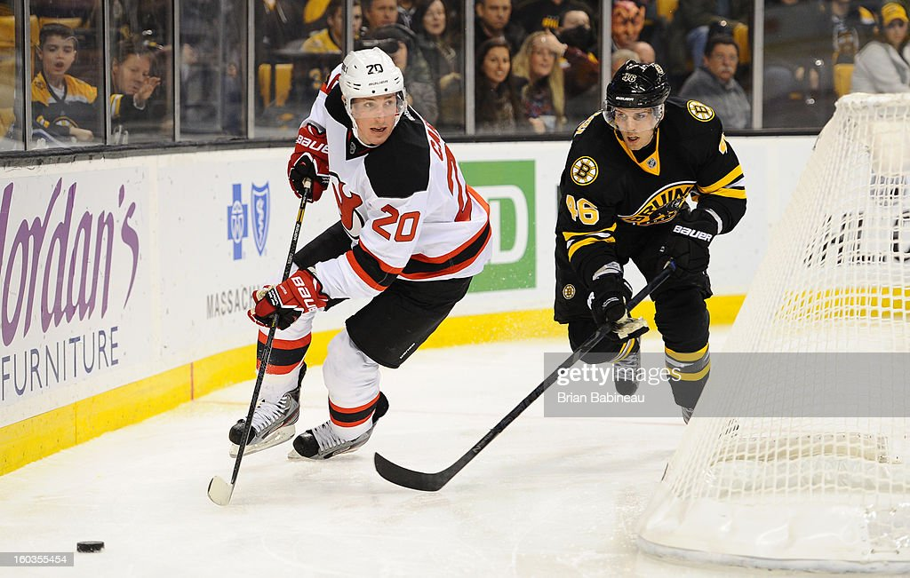 Ryan Carter #20 of the New Jersey Devils skates with the puck against David Krejci #46 of the Boston Bruins at the TD Garden on January 29, 2013 in Boston, Massachusetts.