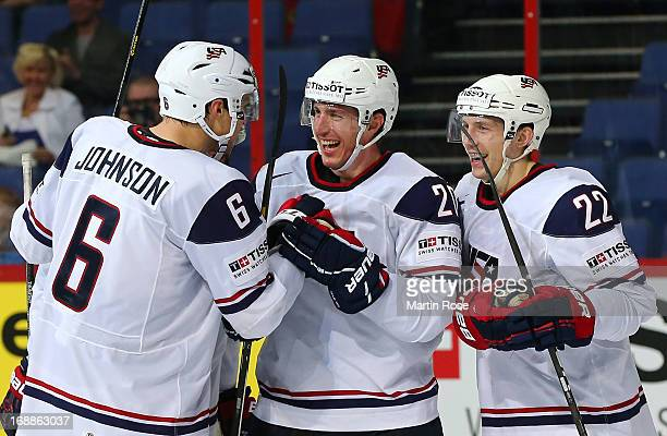 Ryan Carter of USA celebrate with his team mates after he scores his team's 7th goal during the IIHF World Championship quarterfinal match between...