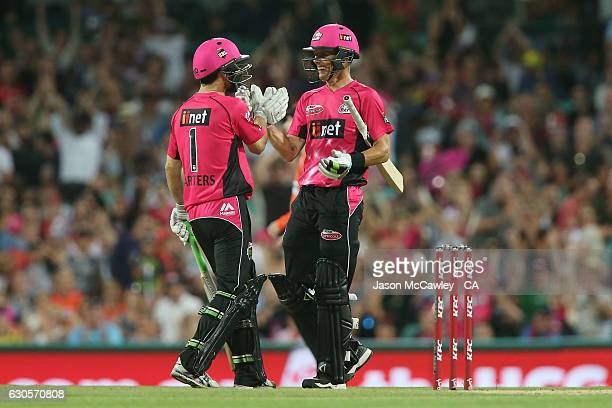 Ryan Carters and Johan Botha of the Sixers celebrate victory during the Big Bash League match between the Sydney Sixers and Perth Scorchers at Sydney...