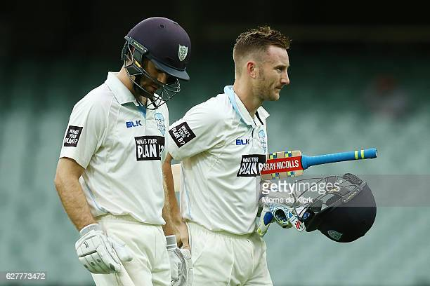 Ryan Carters and Peter Nevill of the NSW Blues come from the field at the dinner break during day one of the Sheffield Shield match between South...