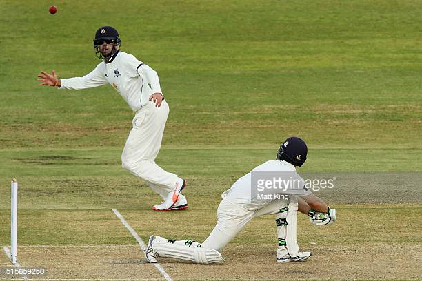 Ryan Carters of the Blues bats as Rob Quiney of the Bushrangers fields during day one of the Sheffield Shield match between Victoria and New South...