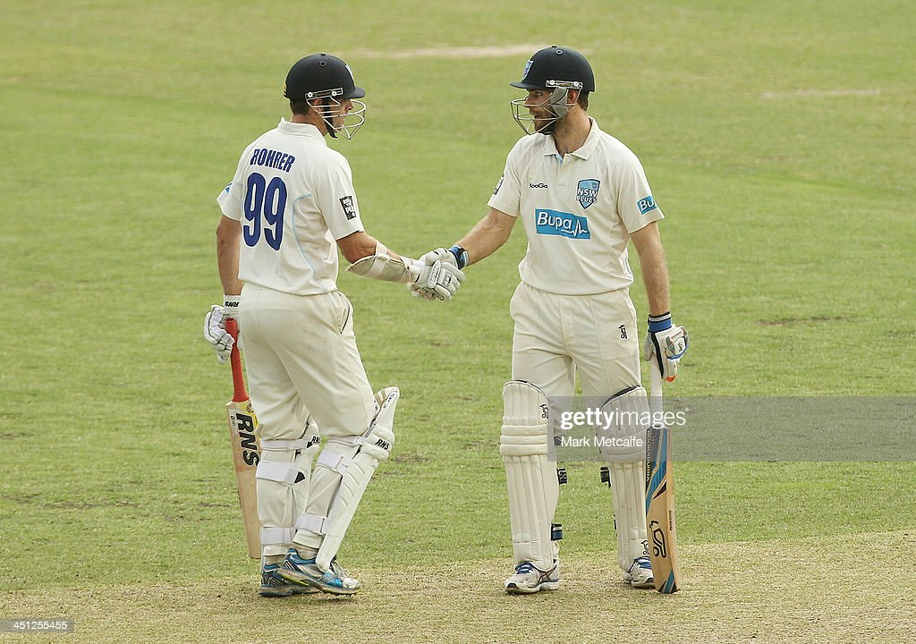 Ryan Carters of the Blues is congratulated by team mate Ben Rohrer after scoring a half century during day one of the Sheffield Shield match between the New South Wales Blues and the Queensland Bulls at Sydney Cricket Ground on November 22, 2013 in Sydney, Australia.