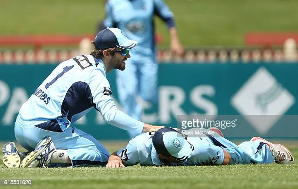 Ryan Carters of the Blues takes a catch to dismiss Adam Voges of the Warriors during the Matador BBQs One Day Cup match between New South Wales and...