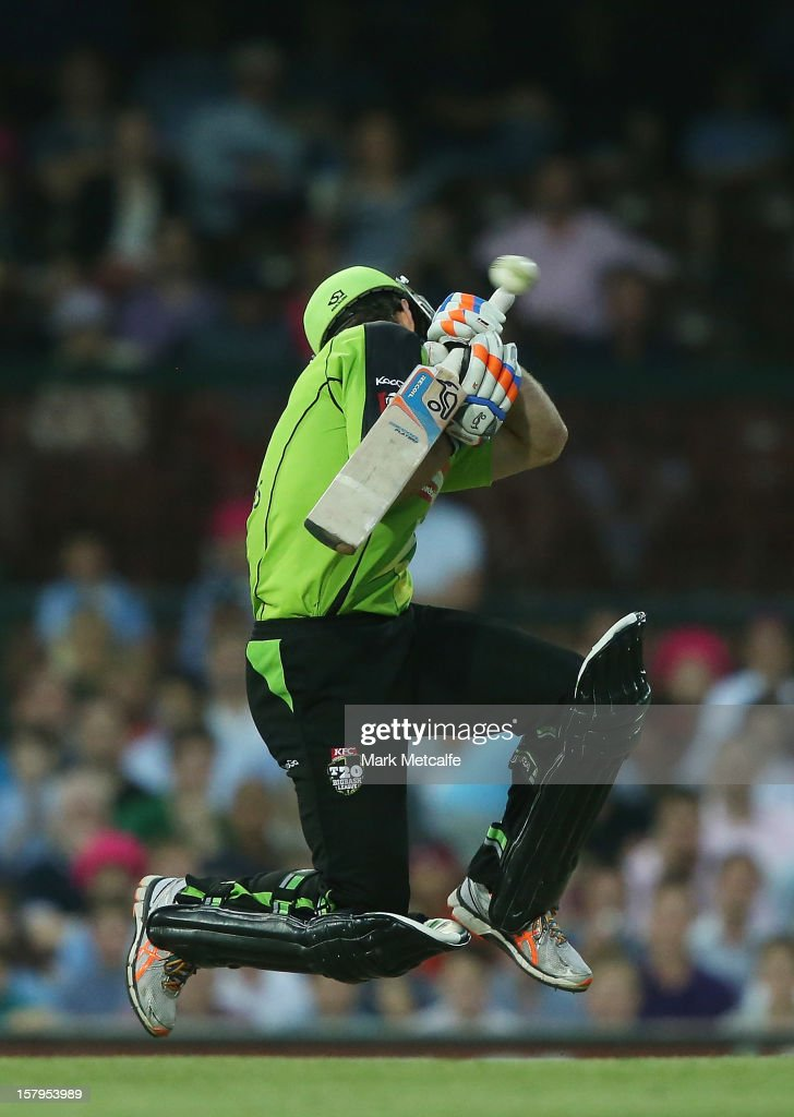 Ryan Carters of the Thunder attempts to evade a delivery from Mitchell Starc of the Sixers during the Big Bash League match between the Sydney Sixers and the Sydney Thunder at Sydney Cricket Ground on December 8, 2012 in Sydney, Australia.