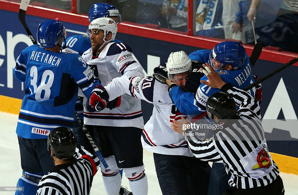 Ryan Cartrer (#21) of USA fights with Ilari Melart (#21) of Finland during the IIHF World Championship group H match between USA and Finland at Hartwall Areena on May 8, 2013 in Helsinki, Finland.