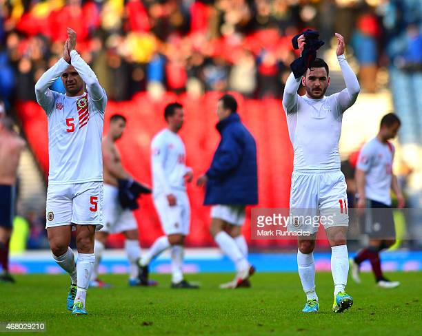 Ryan Casciaro and Jake Gosling of Gibraltar acknowledges the applause from the travelling fans during the EURO 2016 Group D qualifying match between...
