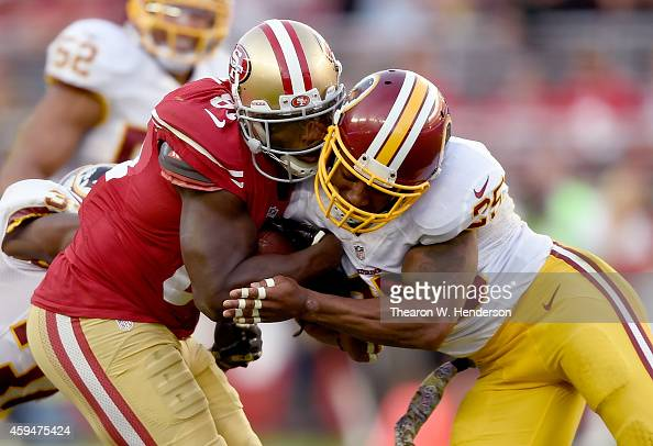 Ryan Clark of the Washington Redskins gets penalized for a helmet to helmet hit on Anquan Boldin of the San Francisco 49ers late in the fourth...