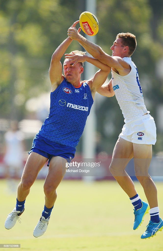 Ryan Clarke (L) and Shaun Atley of the Kangaroos compete for the ball during the North Melbourne AFL Intra-Club match at Arden Street Ground on February 12, 2016 in Melbourne, Australia.