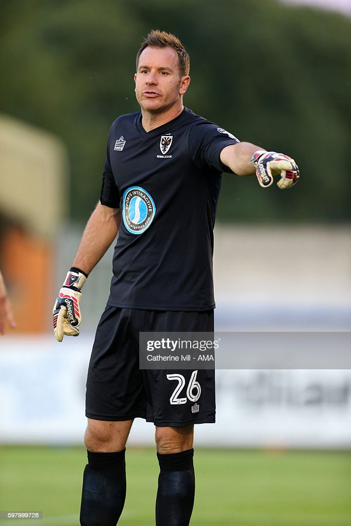 Ryan Clarke of AFC Wimbledon during the Checkatradecom Trophy match between AFC Wimbledon and Swansea City at The Cherry Red Records Stadium on...