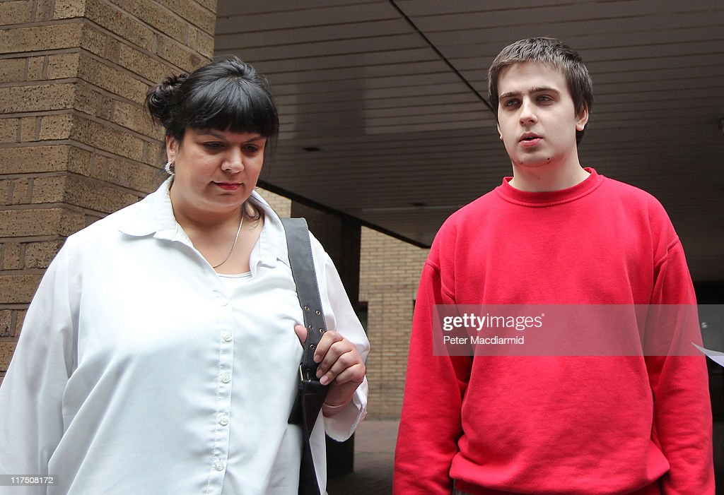 Ryan Cleary (R) stands with his mother Rita Cleary outside Southwark Crown Court on June 27, 2011 in London, England. Mr Cleary is charged with hacking into the website of the United Kingdom's Serious Organised Crime Agency as part of a Scotland Yard and FBI investigation into online hacking group LulzSec.