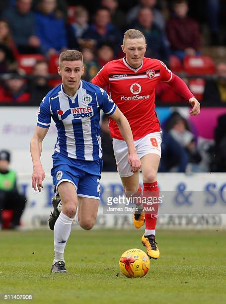 Ryan Colclough of Wigan Athletic and Sam Manton of Walsall in action during the Sky Bet League One match between Walsall and Wigan Athletic at Bescot...