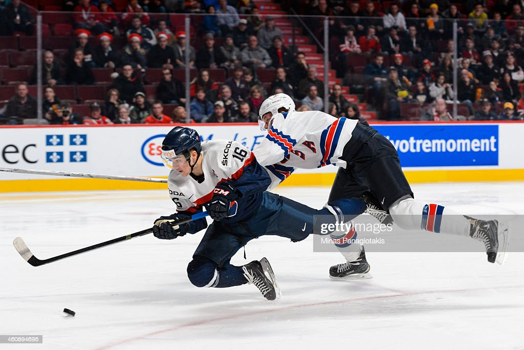 Ryan Collins #6 of Team United States takes down Robert Lantosi #16 of Team Slovakia during the 2015 IIHF World Junior Hockey Championship game at the Bell Centre on December 29, 2014 in Montreal, Quebec, Canada.