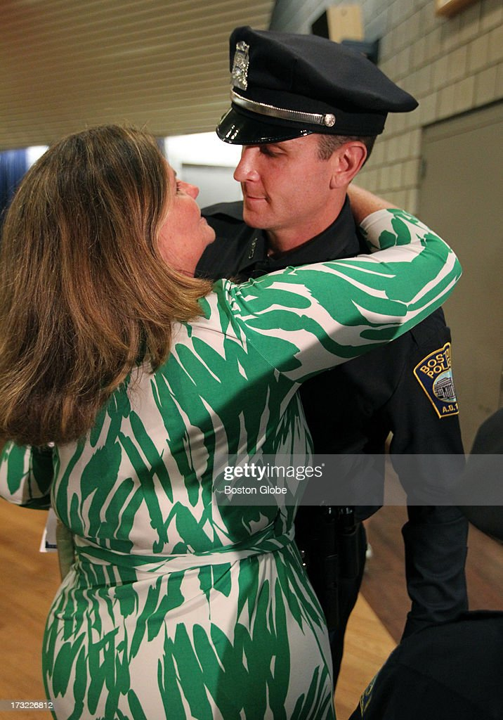 Ryan Connolly, a Boston Police Academy graduate, with his mother, Michelle Connolly, who was a Boston Marathon bombing victim.