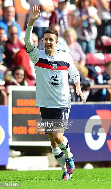 Ryan Conway of Dundee celebrates after scoring a penalty during the Clydesdale Bank Scottish Premier League match between Hearts and Dundee at...