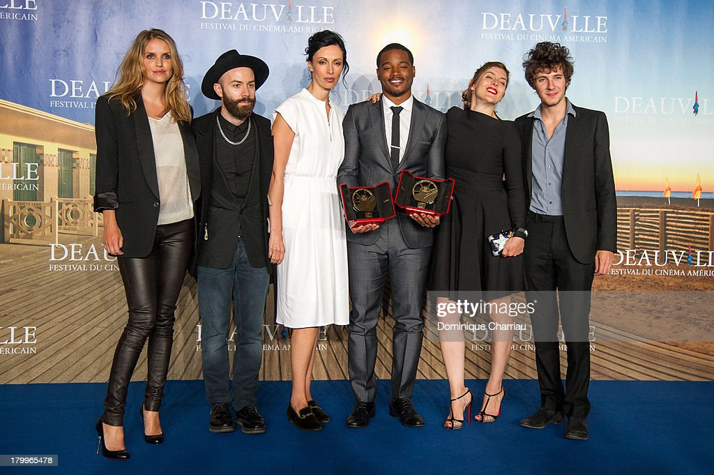 Ryan Coogler (3rdR) flanked by the jury poses with the 'Cartier revelation prize' and the 'Deauville audience award' he won with the film 'Fruitvale station' on September 7, 2013 in Deauville, France.