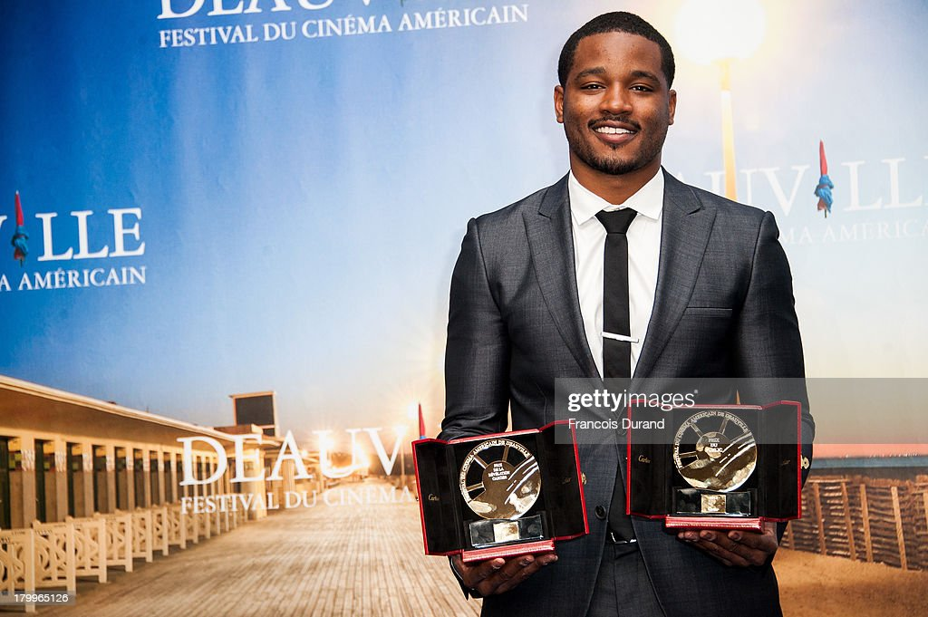 <a gi-track='captionPersonalityLinkClicked' href=/galleries/search?phrase=Ryan+Coogler&family=editorial&specificpeople=7316581 ng-click='$event.stopPropagation()'>Ryan Coogler</a> pose with his prize for the film 'Fruitvale Station' during the 39th Deauville American Film Festival on September 7, 2013 in Deauville, France.