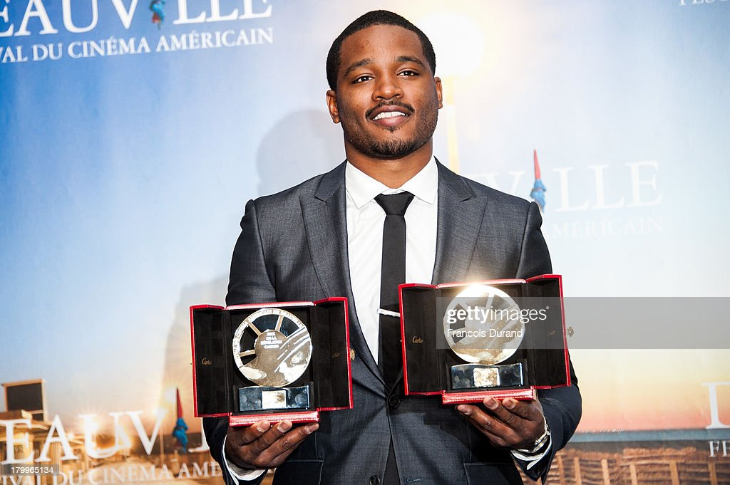 Ryan Coogler pose with his prize for the film 'Fruitvale Station' during the 39th Deauville American Film Festival on September 7, 2013 in Deauville, France.