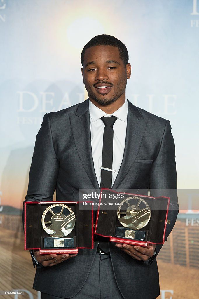 <a gi-track='captionPersonalityLinkClicked' href=/galleries/search?phrase=Ryan+Coogler&family=editorial&specificpeople=7316581 ng-click='$event.stopPropagation()'>Ryan Coogler</a> poses with the 'Cartier revelation prize' and the 'Deauville audience award' he won with the film 'Fruitvale station' on September 7, 2013 in Deauville, France.