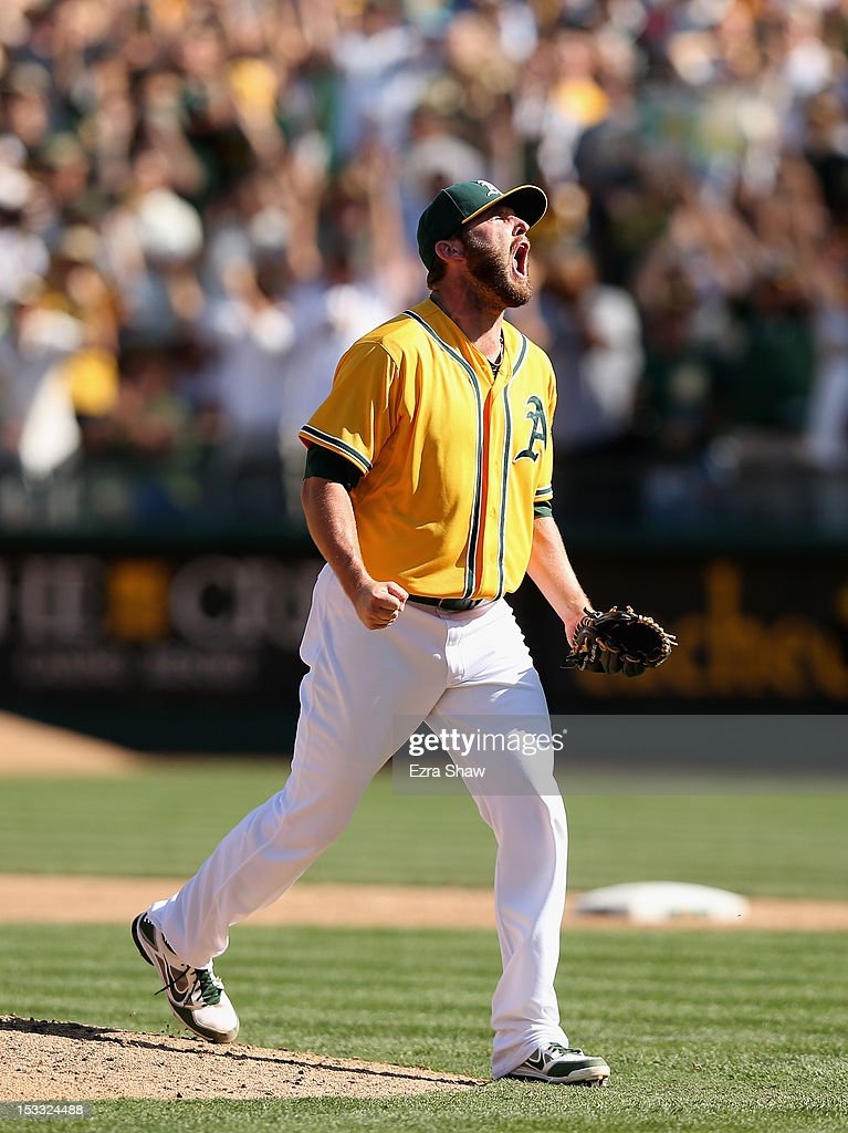 Ryan Cook #48 of the Oakland Athletics reacts after he struck out Mike Napoli #25 of the Texas Rangers to end the seventh inning at O.co Coliseum on October 3, 2012 in Oakland, California.