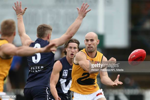 Ryan Cook of WAFL handballs during the match between VFL and WAFL at North Port Oval on May 27 2017 in Melbourne Australia