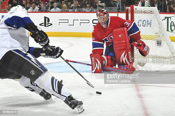 Ryan Craig of Tampa Bay Lightning takes a shot on goalie Carey Price of the Montreal Canadiens during the NHL game on November 07 2009 at the Bell...