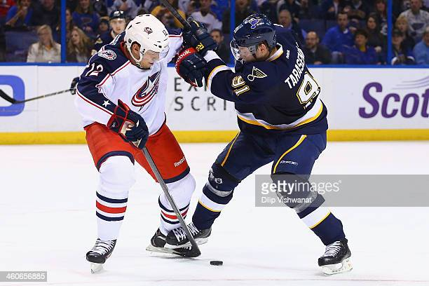 Ryan Craig of the Columbus Blue Jackets blocks a shot on goal by Vladimir Tarasenko of the St Louis Blues at the Scottrade Center on January 4 2014...