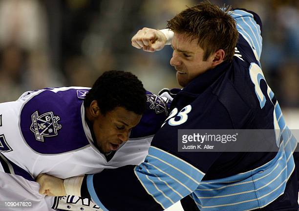 Ryan Craig of the Pittsburgh Penguins mixes it up against Wayne Simmonds of the Los Angeles Kings at Consol Energy Center on February 10 2011 in...
