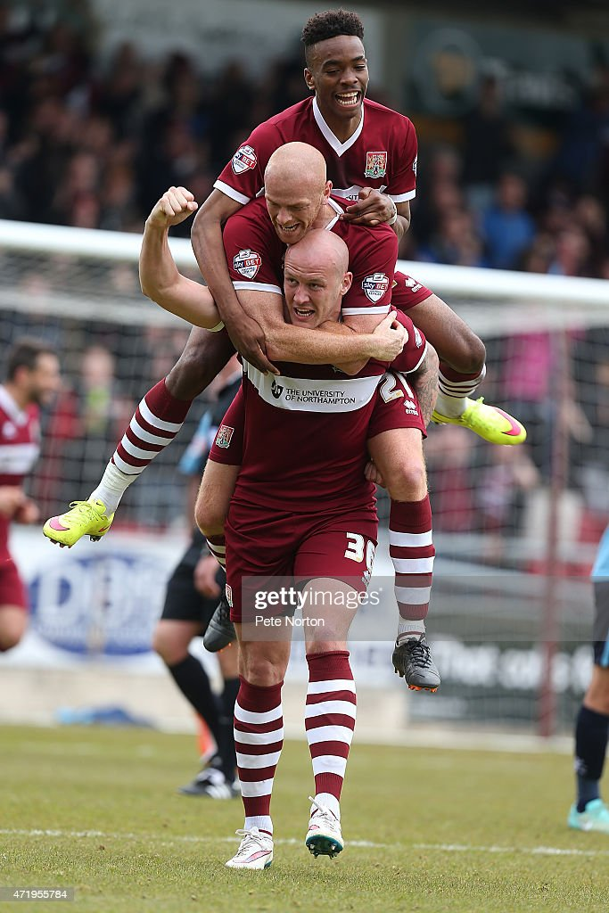 Ryan Cresswell of Northampton Town celebrates with team mates Jason Taylor and Ivan Toney after scoring his sides 2nd goal during the Sky Bet League Two match between Northampton Town and Wycombe Wanderers at Sixfields Stadium on May 2, 2015 in Northampton, England.