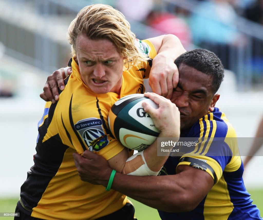 Ryan Cross of the Western Force is tackles by Fetu Vainikolo of the Highlanders during the round six Super 14 match between the Highlanders and the...