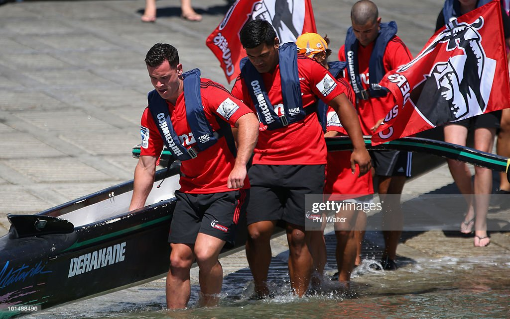 Ryan Crotty (L) and Jordan Taufua (R) of the Crusaders pose before competing in a Wakaama ( outrigger canoe) challenge during the 2013 Super Rugby Season Launch at the Royal Akarana Yacht Club on February 12, 2013 in Auckland, New Zealand.