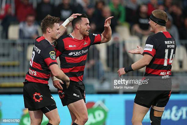 Ryan Crotty Mitchell Drummond and Johnny McNicholl all of Canterbury celebrate after scoring a try during the ITM Cup Premiership Final between...
