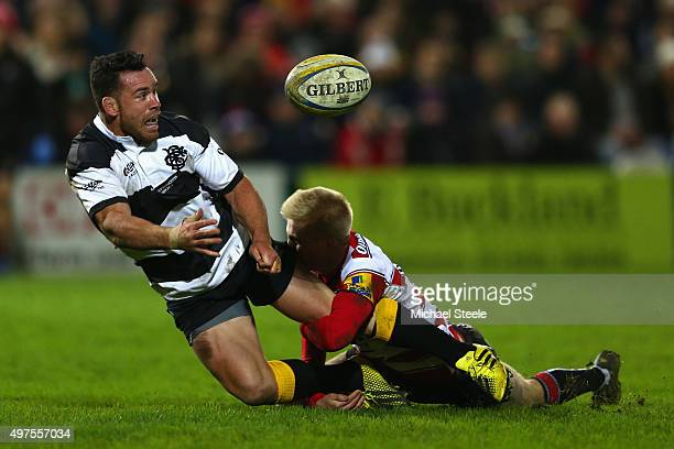 Ryan Crotty of Barbarians offloads as Mat Protheroe of Gloucester challenges during the Gloucester v Barbarians match at Kingsholm Stadium on...