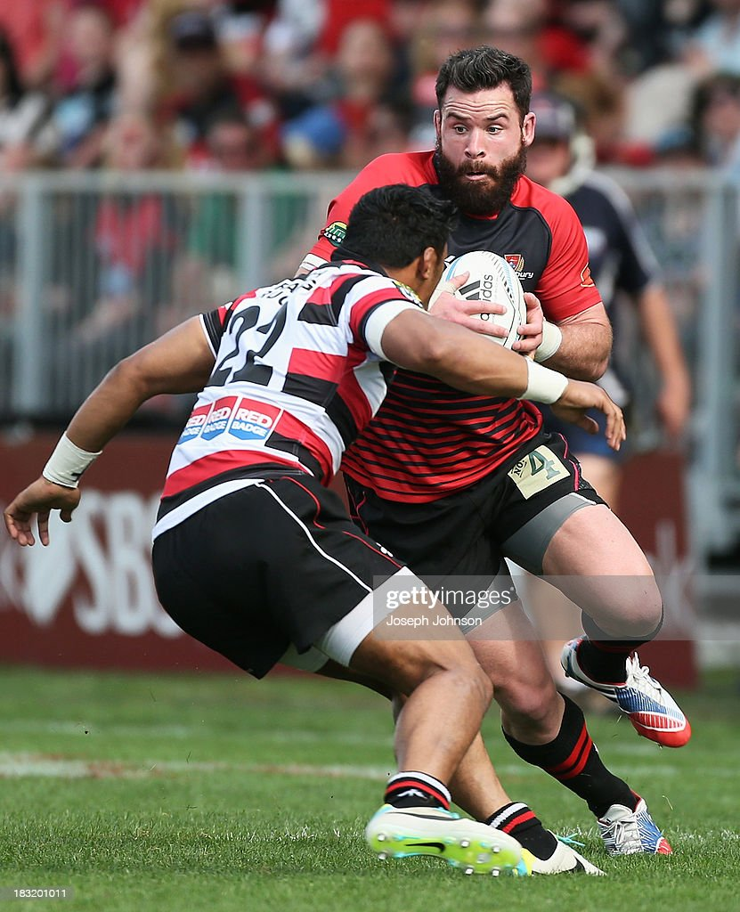 Ryan Crotty of Canterbury with the ball and in defence is Bundee Aki of Counties Manukau during the round eight ITM Cup match between Cantebury and Counties Manukau at AMI Stadium on October 6, 2013 in Christchurch, New Zealand.