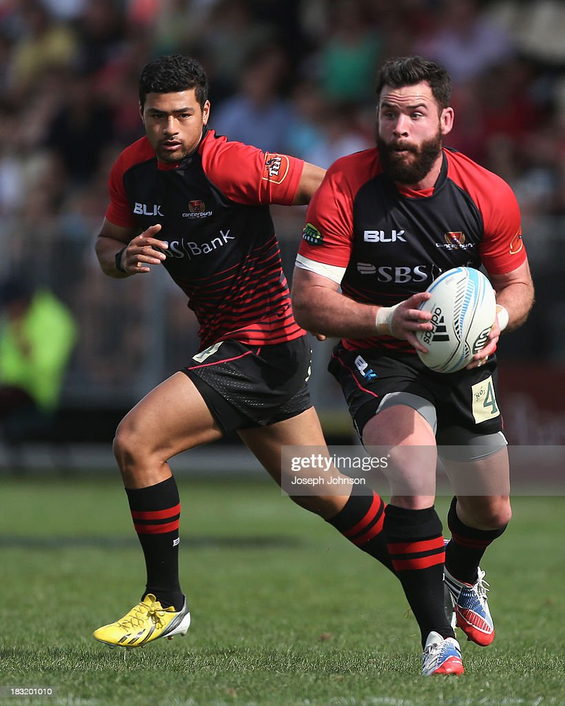 Ryan Crotty of Canterbury with the ball and Richie Mo'unga during the round eight ITM Cup match between Cantebury and Counties Manukau at AMI Stadium on October 6, 2013 in Christchurch, New Zealand.